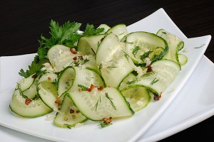 Salad from fresh cucumbers with garl