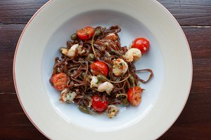 Rye pasta with capers and prawns