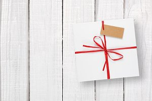 White gift box with tag