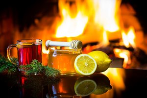Mulled wine, honey, lemon, christmas decoration, fireplace
