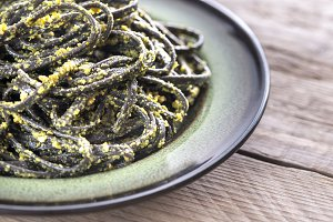 Black pasta with pesto