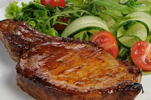 Grilled steak with vegetables on bon