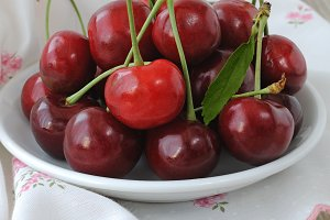 Plate with ripe cherries