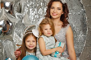 Mother and daughters. Christmas