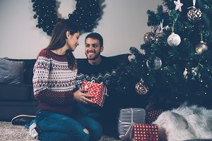 Merry couple with Christmas presents