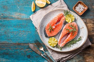 Two fresh raw salmon steaks