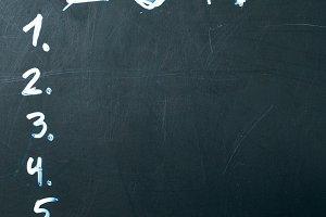 inscription 2017 do it list drawn with chalk on a school blackboard dark