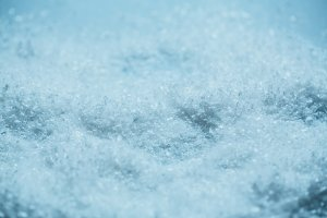 white snow background close up with a blue tone