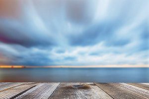 Wooden desk and sky with clouds