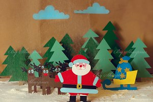 Santa with reindeer in the forest
