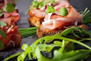 Sliced prosciutto with herbs