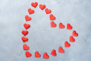 Red hearts on textured background. Love concept