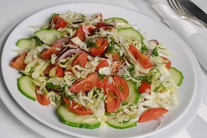 Cabbage salad with cucumber and toma