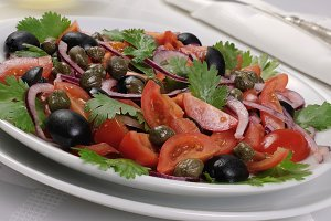 Tomato salad with olives, capers and