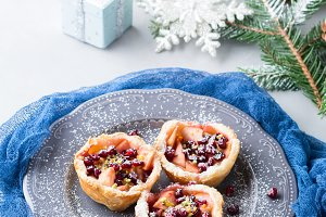 Christmas mini apple pies with pomegranate. Vertical