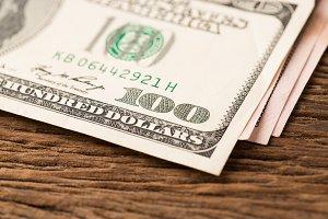 Dollar money on wood table