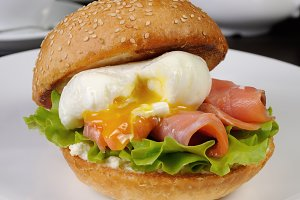 Burger with salmon and poached egg