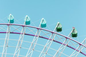 Giant ferris wheel on blue sky