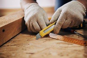 Handyman in gloves