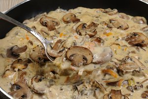 Fried mushrooms in a creamy sauce