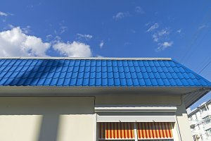 Blue roof against a blue sky.