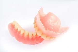 Dental smile jaws teeth on white background. Tooth prosthesis.