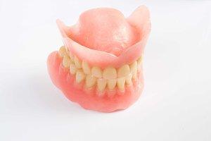 Dental smile jaws teeth on white background. Tooth prosthesis.