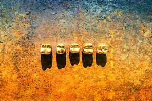 Dental  gold and metal tooth crowns. Isolated.