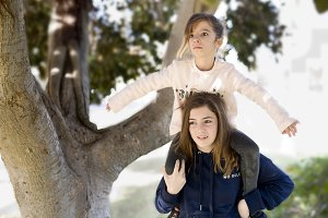 Girl climb on the shoulders