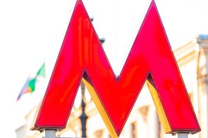 M symbol on the underground lamps background