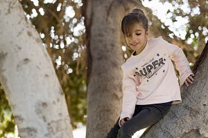 Girl up in a tree.