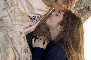 Girl giving him a kiss
