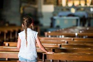 Child in beautiful old church in small italian city