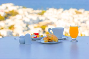 Healthy breakfast in outdoor cafe with amazing view to Cyclades