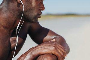 African man wearing earphones