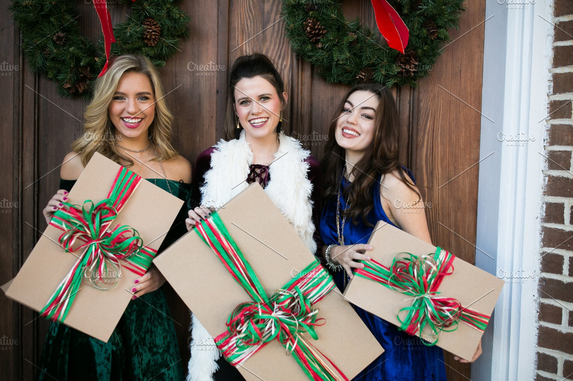 Friends Holding Christmas Presents High Quality Stock Photos