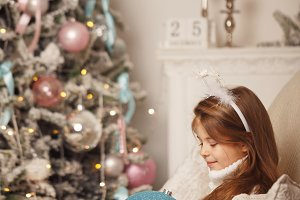 Girl and Christmas decorations