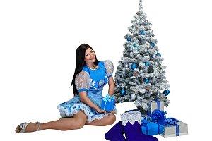Girl near Christmas tree
