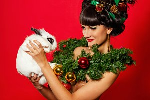 Christmas girl hold rabbit