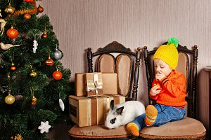 Little girl and rabbit. Christmas