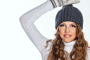 Girl in knitted cap and sweater