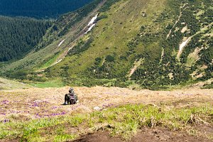 man on a mountain top and enjoy the view of the valley
