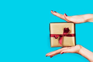Shopping concept with gift box, hand