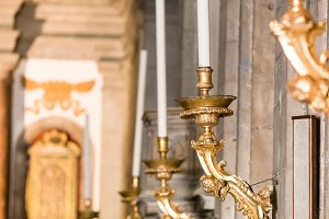 Beautiful antique candle holders in church
