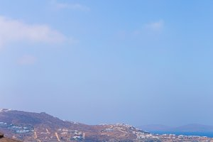 Beautiful view from the edge of infinity pool to the sea and the mountains in the greek town of Mykonos