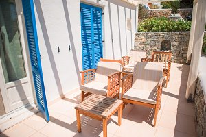 Beautiful terrace in luxury hotel. White architecture on greek island, Greece. Summer holidays