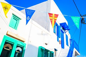 Street with colorful flags in Mykonos, Greece