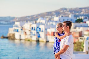 Family in Europe. Father and kid on Little Venice background on Mykonos Island, in Greece