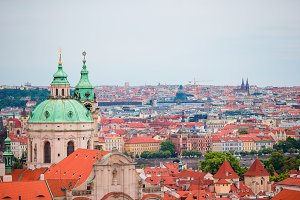 Beautiful view of ancient building with red roofs in Prague, Czech Republic