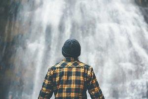 Man enjoying waterfall Traveling